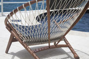 A poolside Hoop Chair by Hans Wegner
