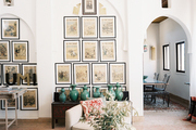 A series of framed art in a living space