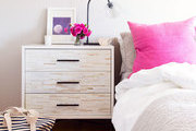 Pink mud cloth pillows on a neutral bed