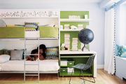 A green desk beside a kid-friendly bunk bed
