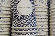 Blue and white paper coffee cups