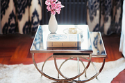 Mirrored nesting tables atop a hide rug