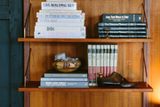 Wooden shelves with an esoteric collection of design books