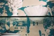 Chinoiserie wallpaper in a kitchen with glass open shelving