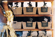 Baskets of throws on a wooden shelving unit