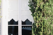 Scalloped white window treatments seen from outside