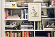Built-in shelves filled with framed art and books