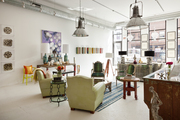 A seating area under industrial-style light fixtures at Buckingham Interiors + Design