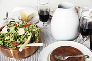 A table setting for a rustic pizza party
