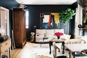 Black walls in an open living-dining area