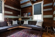 A rustic living space with painted slatted wood walls.