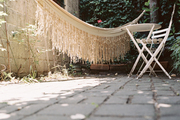 White outdoor furniture and a hammock on a patio