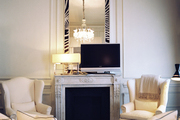 Beige furnishings and a zebra-frame mirror in a neutral living space