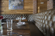 Tufted leather banquettes at the District Miami