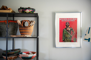 Global rattan storage baskets and wall art in a studio space.