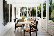 An outdoor dining area on a porch
