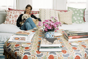 Carolina Irving and her dog in her Manhattan apartment