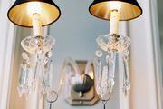 A crystal sconce with black lampshades