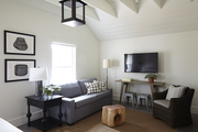 Living room area with white ceiling beams.
