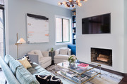 Large scale art hanging in cozy contemporary living space.