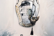 A mirror hung against a white wall