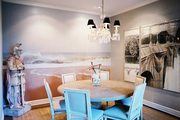 A wallpaper mural in a dining space with a round table and upholstered chairs
