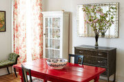 A bright red table in a Brooklyn dining room