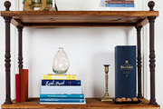 Books and cherished items arranged on a rustic bookcase