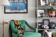 Turquoise vintage chair in living room.