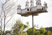 A recycled-aluminum birdhouse resembling a castle
