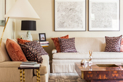 Neutral couches paired with a burl-wood coffee table