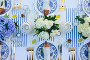 Blue and white china and table linens adorn a festive Bastille Day tabletop