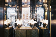 Antiqued-mirror walls surrounding a cabinet