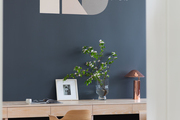 A studio space with a serene blue wall and light wood accents
