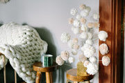 A detail of a tree made with decorative pom poms.