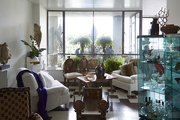 A light-fill living room displaying art and antiques