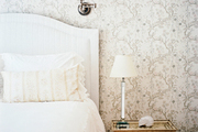 Floral-patterned wallpaper in a guest room