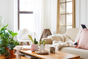 A cozy bohemian living room with soft colors.