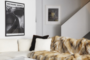 Animal fur and large-scale art in this black and white seating area.