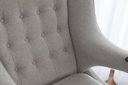 A vintage-inspired upholstered armchair