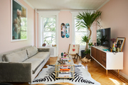 A pink living space with eclectic decor.