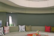 A rounded banquette with patterned pillows