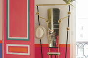 Pink decor and a bird on a fanciful sculpture in a Paris apartment