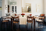 A mixture of chairs surrounding a wooden dining table