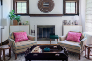 Traditional white, brown, and beige living room with pink accent pillows.
