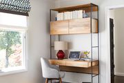 Desk with built-in shelving and modern seating.