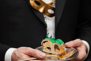 A slice of the king cake at Sam Masters Fat Tuesday Party