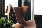 Wingback chair in a modern contemporary living room.