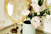 Flowers and a mirror at a vanity