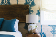 Tan and blue wallpaper brings color and pattern to a guest bedroom
